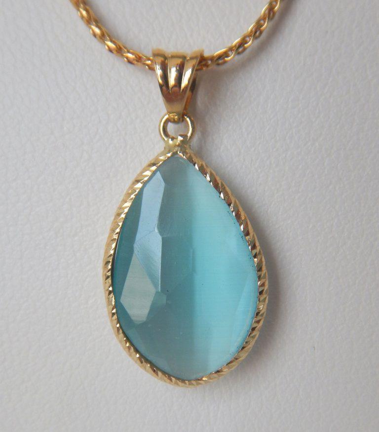 yellow gold chatoyant quartz pendant