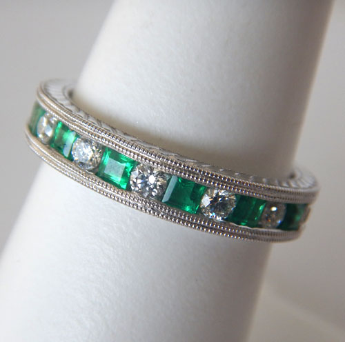 white gold emerald and diamond band with milgrain edges