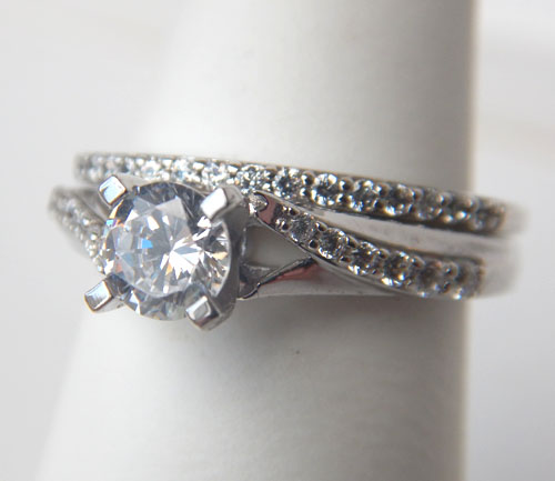 twisted shank diamond engagement ring with matching wedding band