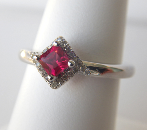 ruby and diamond halo ring in sterling silver setting