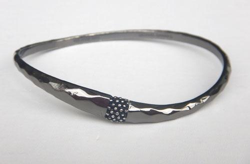 Black rhodium polished sterling silver bangle.