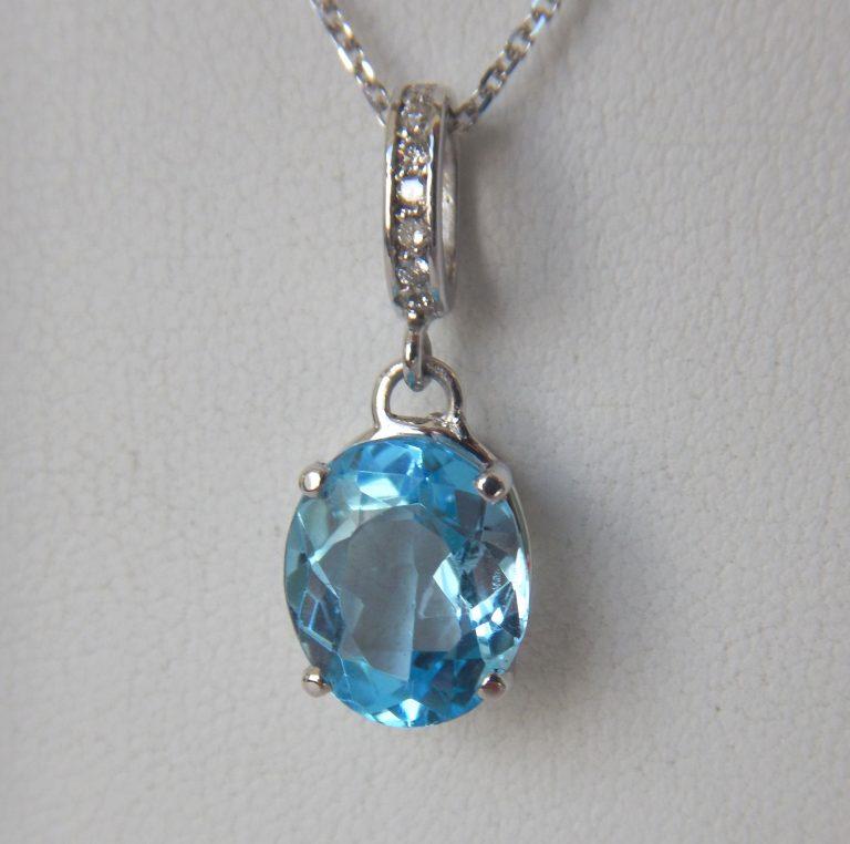 white gold blue topaz pendant with diamond bail