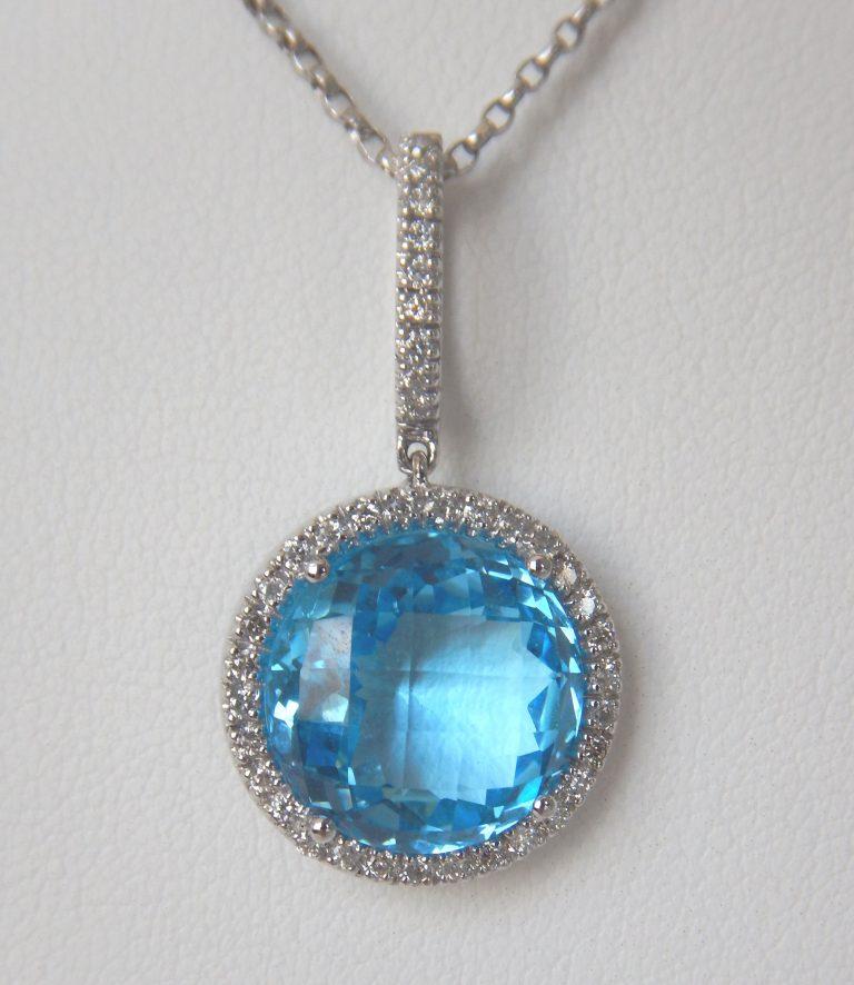 blue topaz and diamond halo pendant
