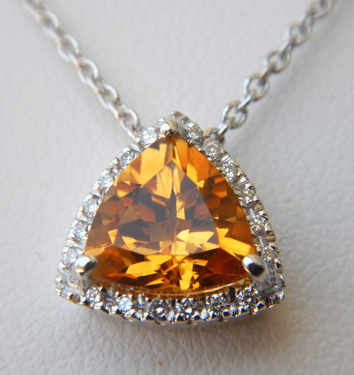 triangular citrine and diamond halo pendant in white gold setting
