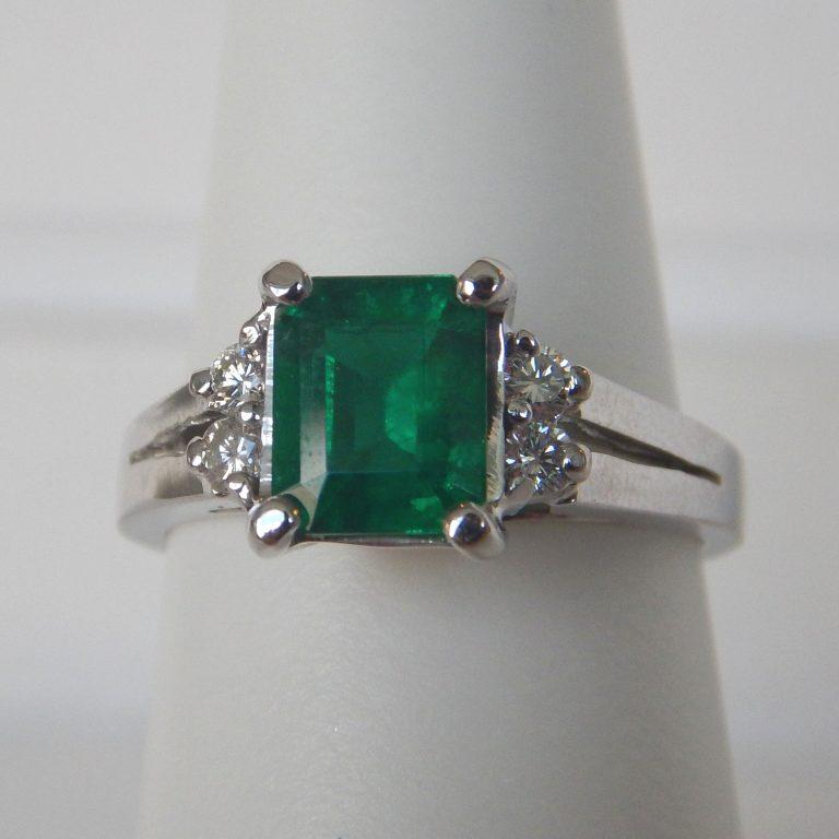 white gold split shank emerald and diamond ring