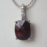 white gold garnet pendant with diamond bail