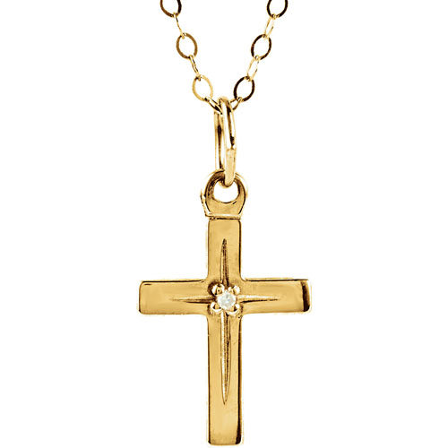 yellow gold cross pendant with a diamond in the center