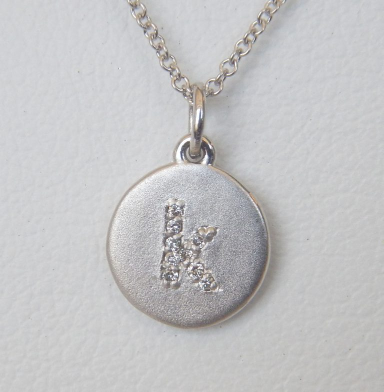 white gold diamond initial pendant