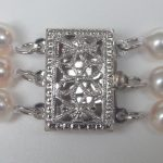 close up view of white gold pearl clasp