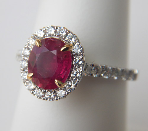 ruby and diamond halo ring in white gold
