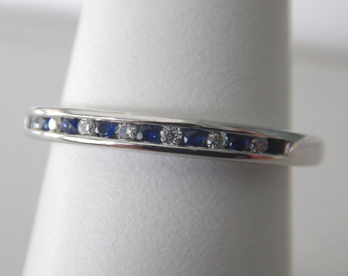sapphire and diamond band in white gold setting