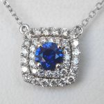 sapphire and diamond halo pendant in white gold