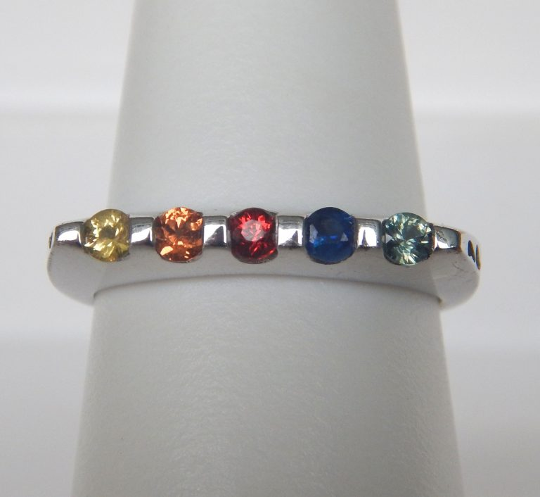 yellow, orange, red, blue, and green sapphire ring