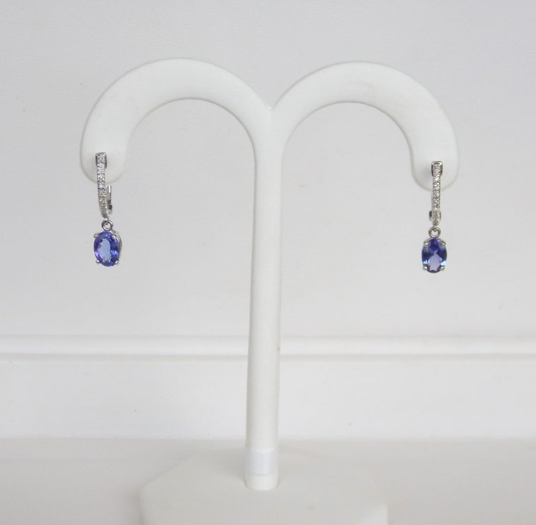 tanzanite and diamond dangle earrings in white gold setting