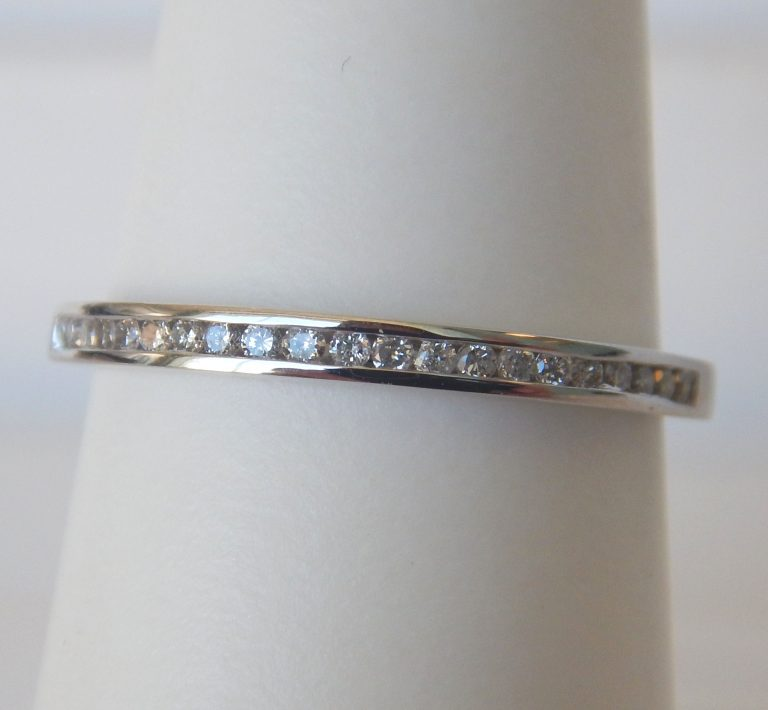 white gold channel set diamond band