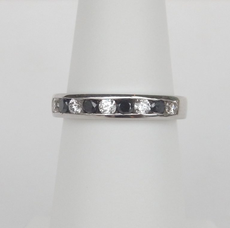 white gold channel set black and colorless diamond band