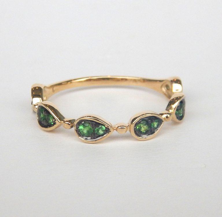 yellow gold tsavorite/green garnet ring