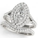 marquise diamond halo engagement ring with matching wedding band