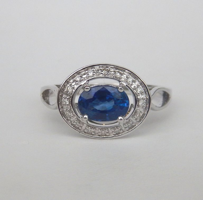 white gold sapphire and diamond halo ring