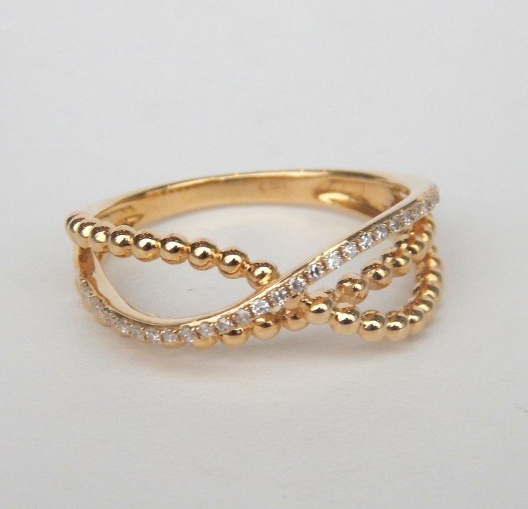 yellow gold twisted diamond ring