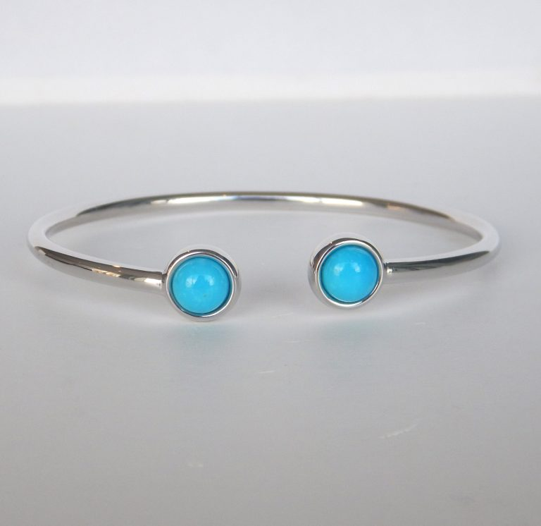 sterling silver open bangle with two turquoise gemstones on the end