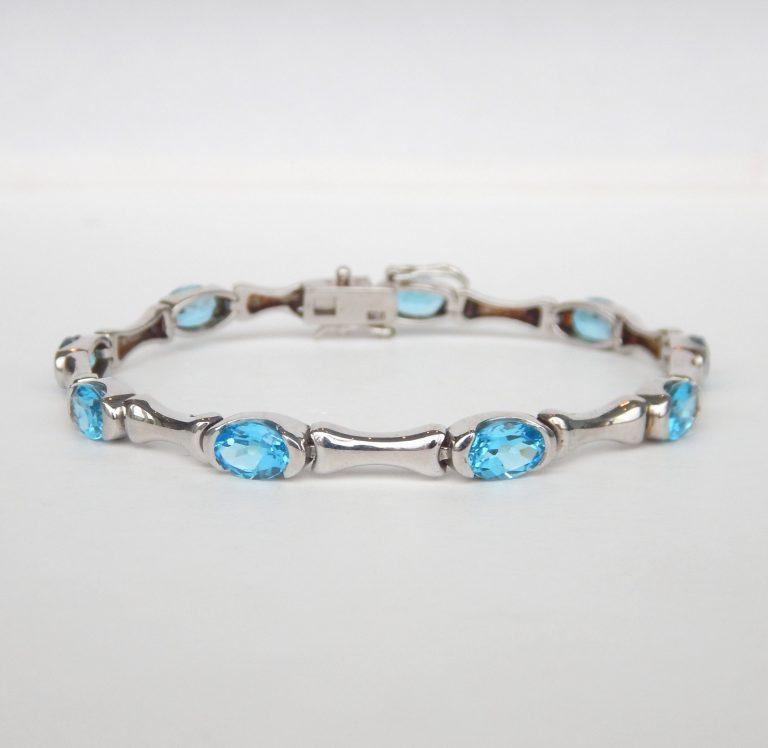 sterling silver bracelet with oval blue topaz gemstones