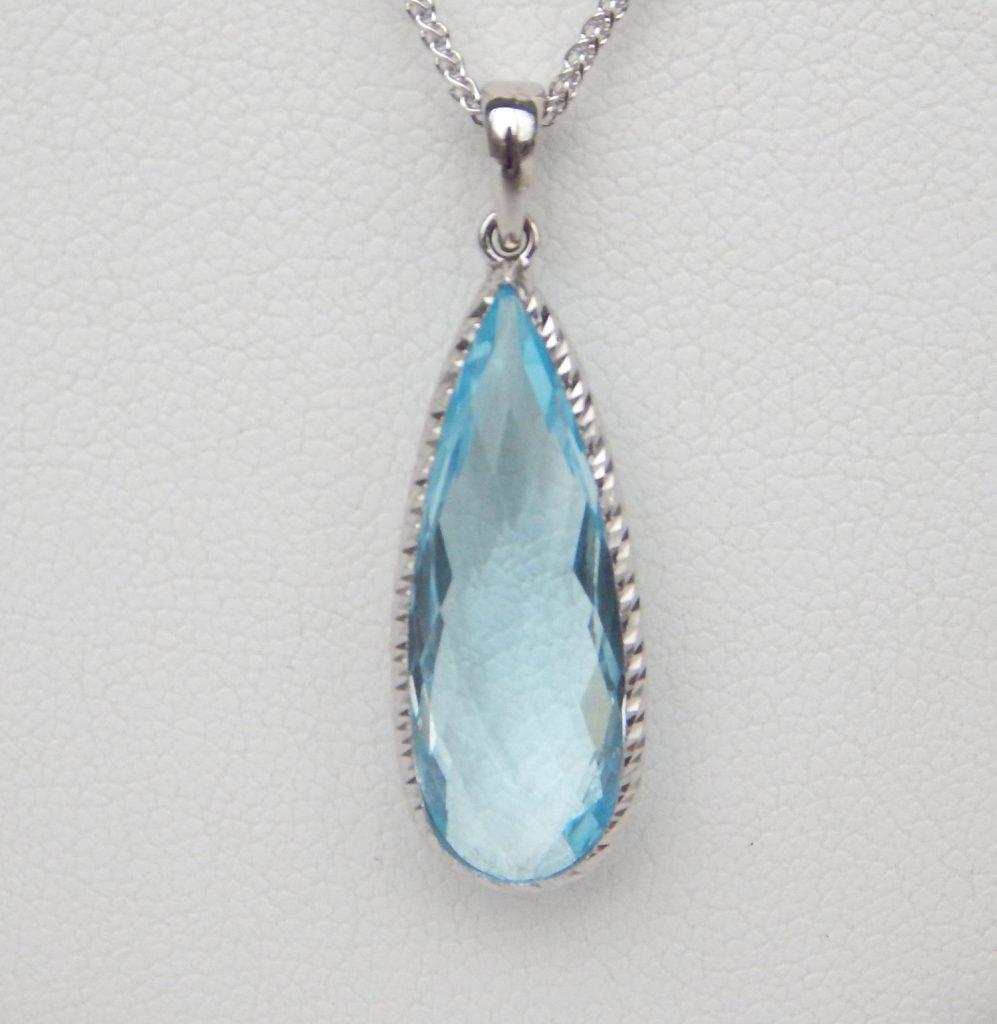 Blue topaz tear drop pendant kloiber jewelers elongated blue topaz pendant in white gold setting aloadofball Image collections
