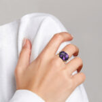 yellow gold amethyst cocktail ring on finger