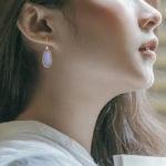 yellow gold aqua agate and diamond dangle earrings on model