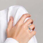 white gold aquamarine and diamond ring on finger