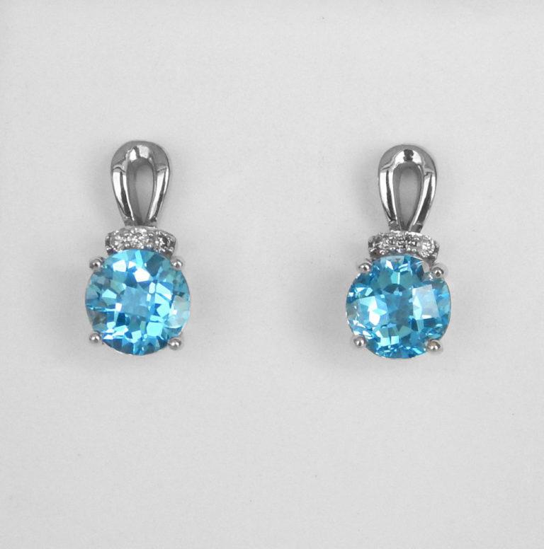white gold blue topaz and diamond dangle earrings