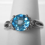 blue topaz and diamond ring in white gold setting