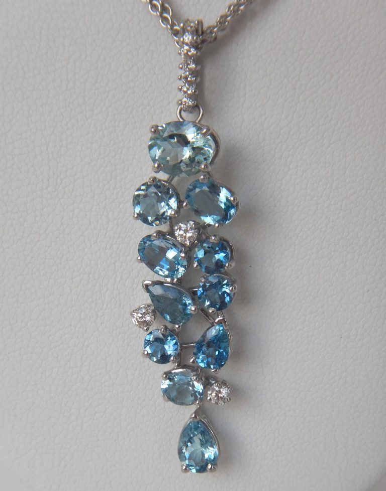 blue zircon and diamond pendant in white gold setting
