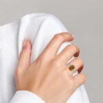 white gold citrine and diamond ring on finger