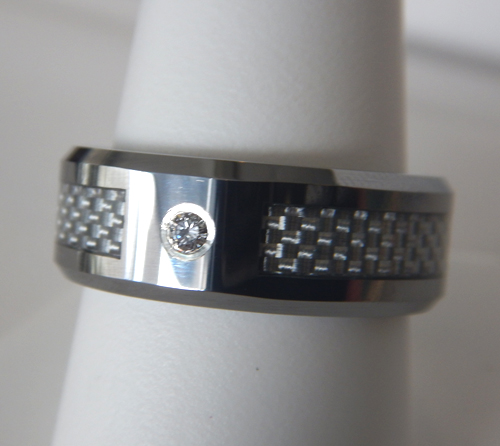 mens wedding band with a single diamond in the center