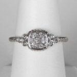 white gold diamond cluster ring on finger