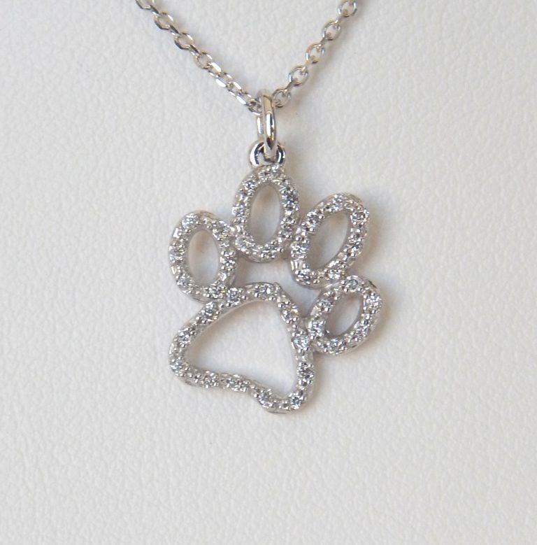 diamond paw print pendant in white gold setting