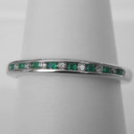 white gold emerald and diamond channel set band