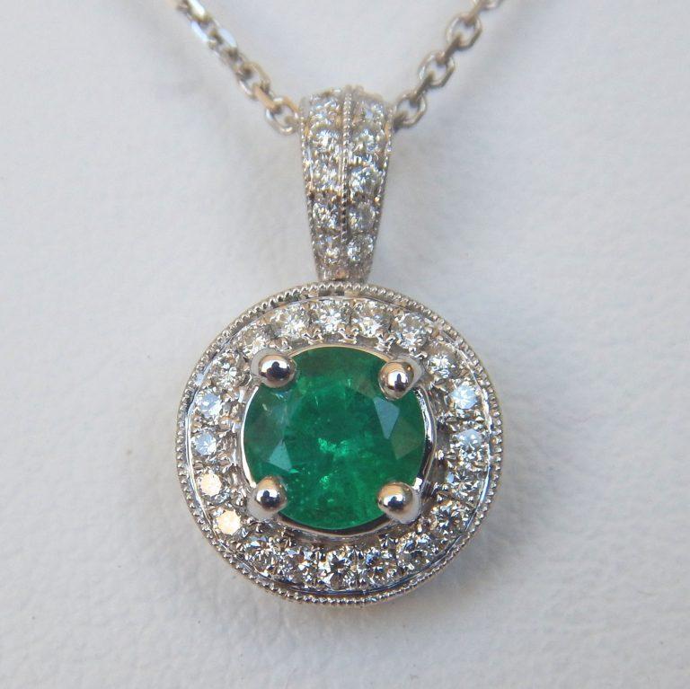 white gold emerald and diamond pendant