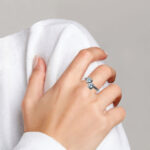 sterling silver two heart aquamarine ring on finger