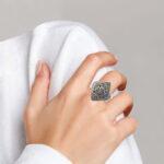 large sterling silver bali ring on finger