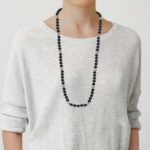 long onyx and pearl necklace on model