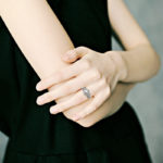 white gold pearl and diamond swirl fashion ring on model