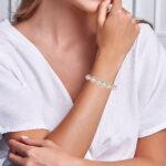 white gold pearl bracelet on wrist