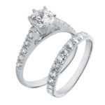 prong set diamond accented engagement ring