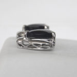 side view of white gold black onyx earrings