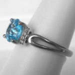 side view of blue topaz and diamond ring