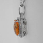 side view of white gold citrine and diamond pendant