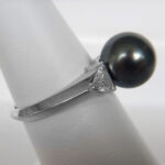 side view of white gold tahitian pearl and diamond ring