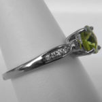 side view of white gold peridot and diamond ring